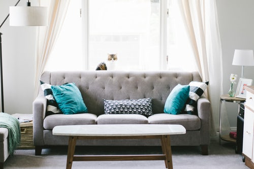 a grey sofa that our furniture movers Las Vegas can move