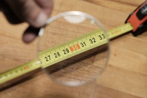 Use a magnifying glass with your measuring tape if you need to.