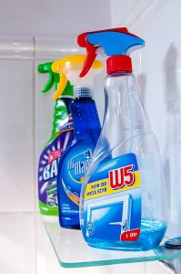Use cleaning supplies thoroughly when you prepare your fridge for moving.