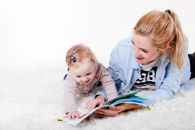 Mom reading to her baby girl