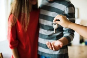 couple with keys in hand