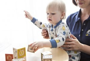 a baby playing with cubes