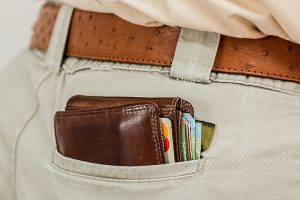 A thick, full wallet in a back pocket of a man who knows how to boost your relocation budget