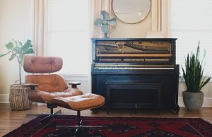 furniture with a piano in the corner