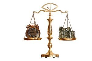 Money and clock on scale