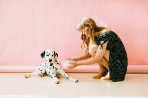 A woman with a dalmatian