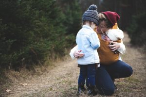 A mom with a baby and a little girl - prepare your kids for moving day