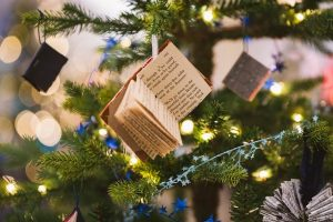 A book on Christmas tree, pointing that you need to store Christmas decoration smartly