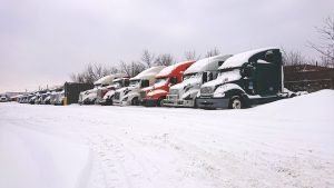 Parked truck covered in snow