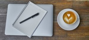 Picture of tools necessary for preparing for moving day - coffee and checklist