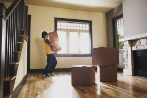 Boy carrying moving boxes