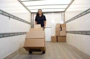 Woman loading a moving truck