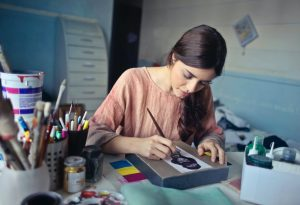 A girl working on a small painting