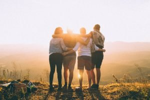 A group of friends looking at the sunset