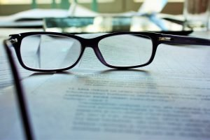 glasses on the piece of paper - before signing a moving contract