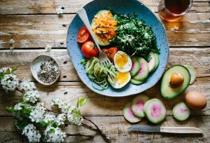 Staying healthy while moving by eating eggs vegetables and avocado