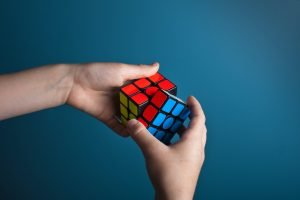 person solving the magic cube