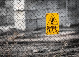 yellow sign on the fence