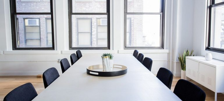 an empty office with chairs and a table