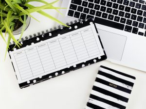 planner,notepad and laptop keyboard