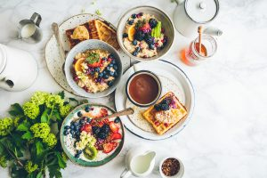 A rich breakfast on a white table
