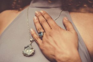a ring and a necklase on a woman