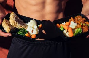 A man holding great meal ideas for the day of your move