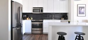 brightly lit kitchen with appliances