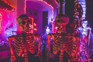 two skeletons as 2020 Halloween decorations to use in Vegas