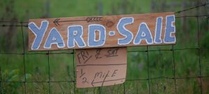 a yard sale sign to help you pack and prepare without burning a hole in your pocket