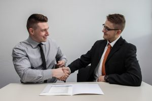 Two people making a deal