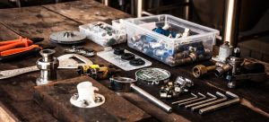 a table filled with tools to disassemble common household appliances