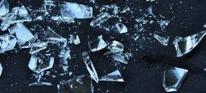 shattered glass on a black surface