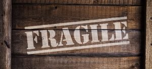 """a box with """"fragile"""" written on it"""