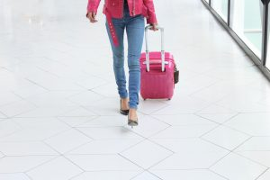 woman pulling a suitcase
