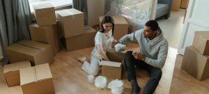 a couple unpacking their living room