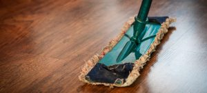 a mop cleaning the wooden floor