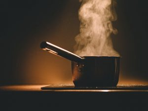 a pot on cooker - prepare meals for the moving day