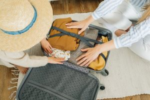 packing and applying pressure on items in a suitcase