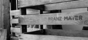 a black and white picture of a wooden crate for you to pack a wine collection for relocation