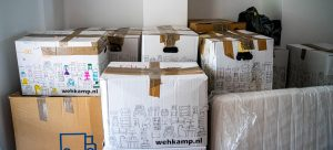 a stack of boxes and a mattress after packing your guest room