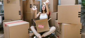 Woman surrounded by boxes.