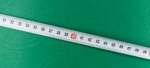 a tape measure on a green surface