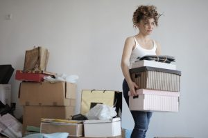 a woman holding boxes