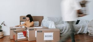 a couple utilizing practical ways to pack their home before moving