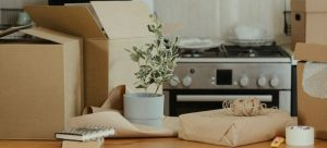 Boxes on kitchen wooden table