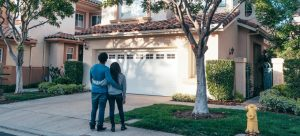 a couple looking at their home before utilizing precautionary measures to take before buying a house