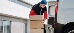 Man loading boxes in the van