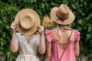handle the summer heat when moving by wearing hats