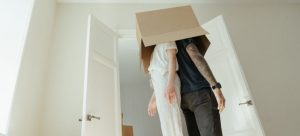 A couple with a box covering their head